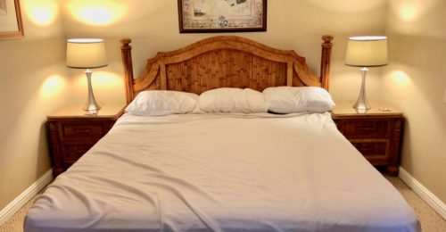 Queen size bed with white sheets